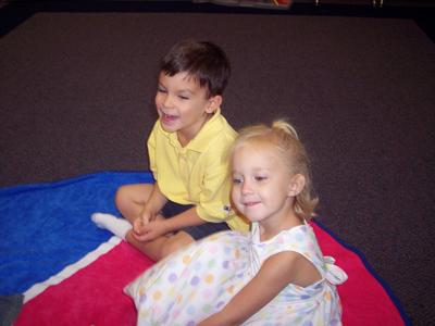 Two classmates enjoying storytime
