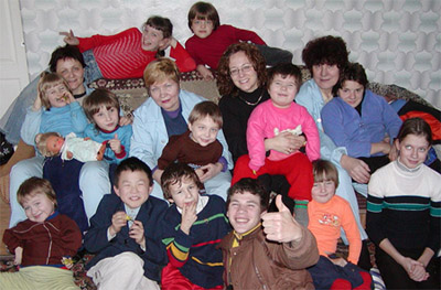 Tammy (top/center/right) with children and workers from a Ukrainian orphanage.