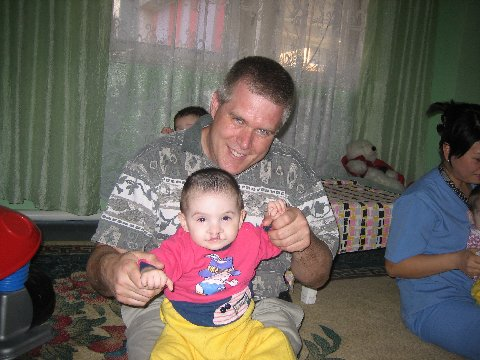 Dave Wright of Possibilities International with a friend from an orphanage in Central Asia